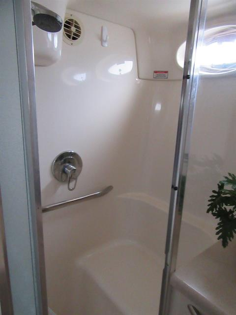 Full size enclosed separate shower in Master Suite.