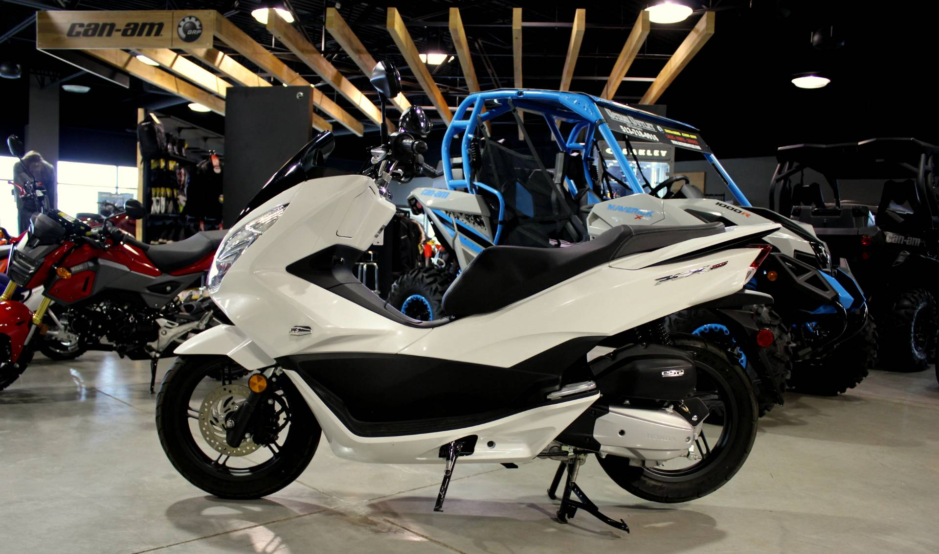 takahiro featured production unveiled to of s hybrid motor all goal honda hachigo pcx two thirds that the is added ceo president increase evs bikesrepublic electric and part