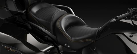 Embossed seat with 10th Anniversary logo and gold stitching