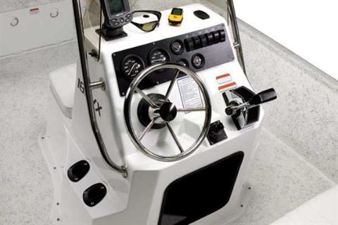 At the helm is a stainless steel destroyer-type steering wheel.