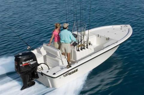 A fully molded composite liner incorporates integrated bow and stern fishing platforms.