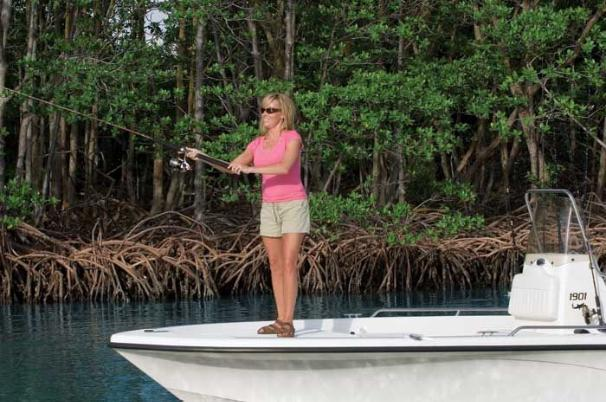 This model features a fully molded composite liner with integrated bow and stern platforms and non-skid surface.